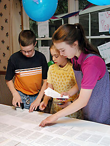 Jesse, Mary, and Anna stamping tracts