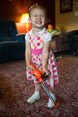 Christina loves Joshua's chainsaw! The cousins do a great job of sharing it.