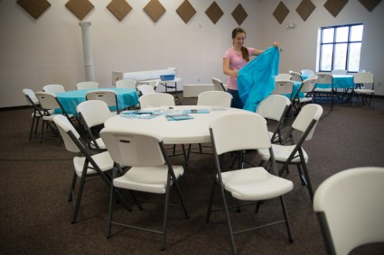 We set some of the tables up for the rehearsal dinner, while others were made ready for the reception.