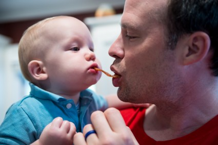 Drew trying bacon with Daddy.