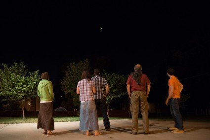 Looking at the lunar eclipse from our driveway.