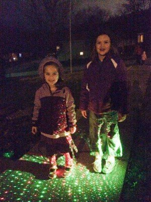 "I've sure most are aware of ""lazy lights"": the new laser Christmas lights. The girls posed for a picture for me."
