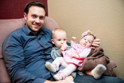 John with a lap full. Drew loves Calia.