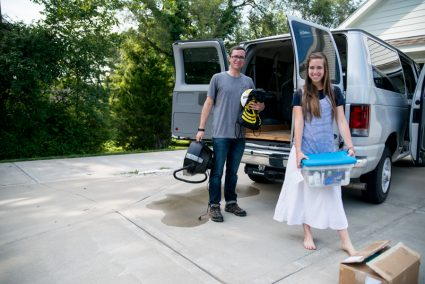 Jesse Maxwell and Mary Maxwell unloading