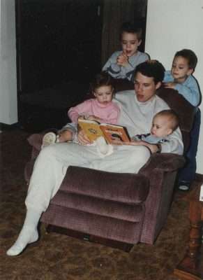Here he is -- reading to Joseph, John, Anna, and Jesse