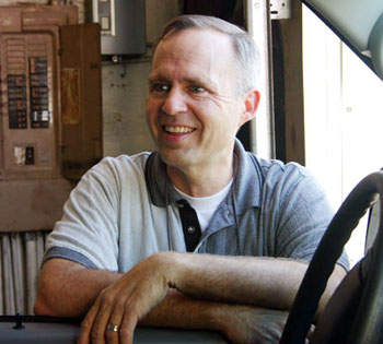 Dad - at the repair shop (still smiling!)