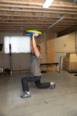 John doing overhead lunges.