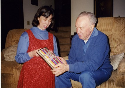 Mom showing Grandad the book.