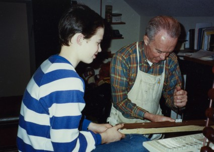 Grandad and Nathan doing a project together.