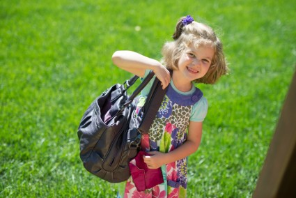 Who can't help but smile with this precious load? Bethany wanted to carry my camera bag.