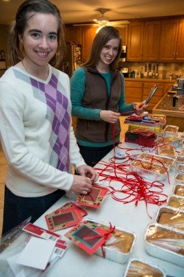 Even cutting ribbon and tying the cards onto 40 loaves takes awhile ;). Here Mary and I are working.