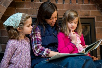 Betsy, Anna, and Abby reading together.