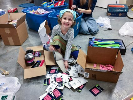 Betsy opening up eraser boxes.